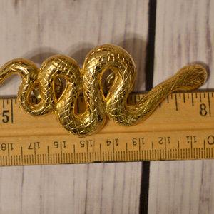large gold vintage snake pin brooch